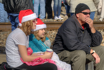 Children await with hot chocolate and blankets for the train's arrival during the 72nd Annual Santa Train in St. Paul, VA on Saturday, November 22, 2014. Copyright 2014 Jason Barnette  The Santa Train is an annual Christmas event, usually the weekend before Thanksgiving, that started in 1943. The train begins in Shelby, Kentucky, winds through a few towns in Southwest Virginia, before ending in Kingsport, Tennessee in time for the Santa to hop on a float for the Christmas parade. The event features a Santa Claus who tosses out candy, shirts, games, and plush animals to the crowds that gather at specific locations.