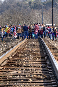 A large crowd gathers about a half hour before the train's arrive during the 72nd Annual Santa Train in St. Paul, VA on Saturday, November 22, 2014. Copyright 2014 Jason Barnette  The Santa Train is an annual Christmas event, usually the weekend before Thanksgiving, that started in 1943. The train begins in Shelby, Kentucky, winds through a few towns in Southwest Virginia, before ending in Kingsport, Tennessee in time for the Santa to hop on a float for the Christmas parade. The event features a Santa Claus who tosses out candy, shirts, games, and plush animals to the crowds that gather at specific locations.
