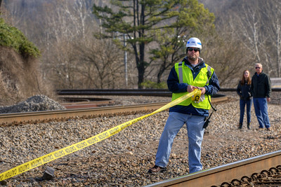 A CSX employee rolls out caution tape to keep the crowd a safe distance back the tracks before the train's arrival during the 72nd Annual Santa Train in St. Paul, VA on Saturday, November 22, 2014. Copyright 2014 Jason Barnette  The Santa Train is an annual Christmas event, usually the weekend before Thanksgiving, that started in 1943. The train begins in Shelby, Kentucky, winds through a few towns in Southwest Virginia, before ending in Kingsport, Tennessee in time for the Santa to hop on a float for the Christmas parade. The event features a Santa Claus who tosses out candy, shirts, games, and plush animals to the crowds that gather at specific locations.