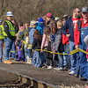 CSX employees help keep the crowd behind a caution tape at a safe distance from the tracks before the train's arrival during the 72nd Annual Santa Train in St. Paul, VA on Saturday, November 22, 2014. Copyright 2014 Jason Barnette  The Santa Train is an annual Christmas event, usually the weekend before Thanksgiving, that started in 1943. The train begins in Shelby, Kentucky, winds through a few towns in Southwest Virginia, before ending in Kingsport, Tennessee in time for the Santa to hop on a float for the Christmas parade. The event features a Santa Claus who tosses out candy, shirts, games, and plush animals to the crowds that gather at specific locations.