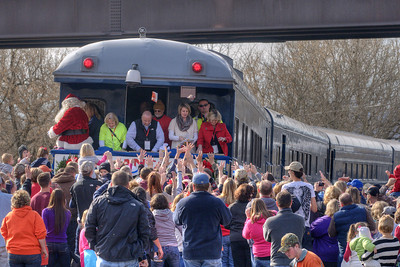 People crowd around the end of the train during the 72nd Annual Santa Train in Fort Blackmore, VA on Saturday, November 22, 2014. Copyright 2014 Jason Barnette  The Santa Train is an annual Christmas event, usually the weekend before Thanksgiving, that started in 1943. The train begins in Shelby, Kentucky, winds through a few towns in Southwest Virginia, before ending in Kingsport, Tennessee in time for the Santa to hop on a float for the Christmas parade. The event features a Santa Claus who tosses out candy, shirts, games, and plush animals to the crowds that gather at specific locations.