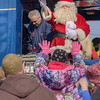 Santa Claus tosses out toys, clothing, and candy during the 72nd Annual Santa Train in St. Paul, VA on Saturday, November 22, 2014. Copyright 2014 Jason Barnette  The Santa Train is an annual Christmas event, usually the weekend before Thanksgiving, that started in 1943. The train begins in Shelby, Kentucky, winds through a few towns in Southwest Virginia, before ending in Kingsport, Tennessee in time for the Santa to hop on a float for the Christmas parade. The event features a Santa Claus who tosses out candy, shirts, games, and plush animals to the crowds that gather at specific locations.