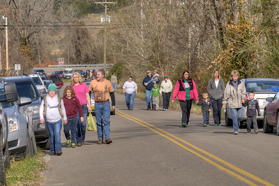 People park and walk along the two lane road leading to the railroad tracks during the 72nd Annual Santa Train in Fort Blackmore, VA on Saturday, November 22, 2014. Copyright 2014 Jason Barnette  The Santa Train is an annual Christmas event, usually the weekend before Thanksgiving, that started in 1943. The train begins in Shelby, Kentucky, winds through a few towns in Southwest Virginia, before ending in Kingsport, Tennessee in time for the Santa to hop on a float for the Christmas parade. The event features a Santa Claus who tosses out candy, shirts, games, and plush animals to the crowds that gather at specific locations.