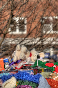 A pile of plush animals and potato chips ready for Santa during the 72nd Annual Santa Train in Kingsport, TN on Saturday, November 22, 2014. Copyright 2014 Jason Barnette  The Santa Train is an annual Christmas event, usually the weekend before Thanksgiving, that started in 1943. The train begins in Shelby, Kentucky, winds through a few towns in Southwest Virginia, before ending in Kingsport, Tennessee in time for the Santa to hop on a float for the Christmas parade. The event features a Santa Claus who tosses out candy, shirts, games, and plush animals to the crowds that gather at specific locations.