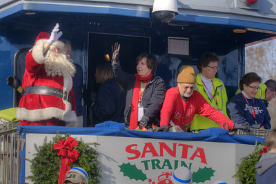 Santa Claus waves from the rear of the train during the 72nd Annual Santa Train in St. Paul, VA on Saturday, November 22, 2014. Copyright 2014 Jason Barnette  The Santa Train is an annual Christmas event, usually the weekend before Thanksgiving, that started in 1943. The train begins in Shelby, Kentucky, winds through a few towns in Southwest Virginia, before ending in Kingsport, Tennessee in time for the Santa to hop on a float for the Christmas parade. The event features a Santa Claus who tosses out candy, shirts, games, and plush animals to the crowds that gather at specific locations.