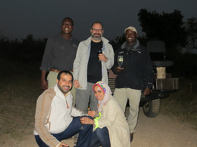 (L to R) Mike, Joe, Joe, Mohammed, and Hanna having drinks and snacks before heading back to camp.