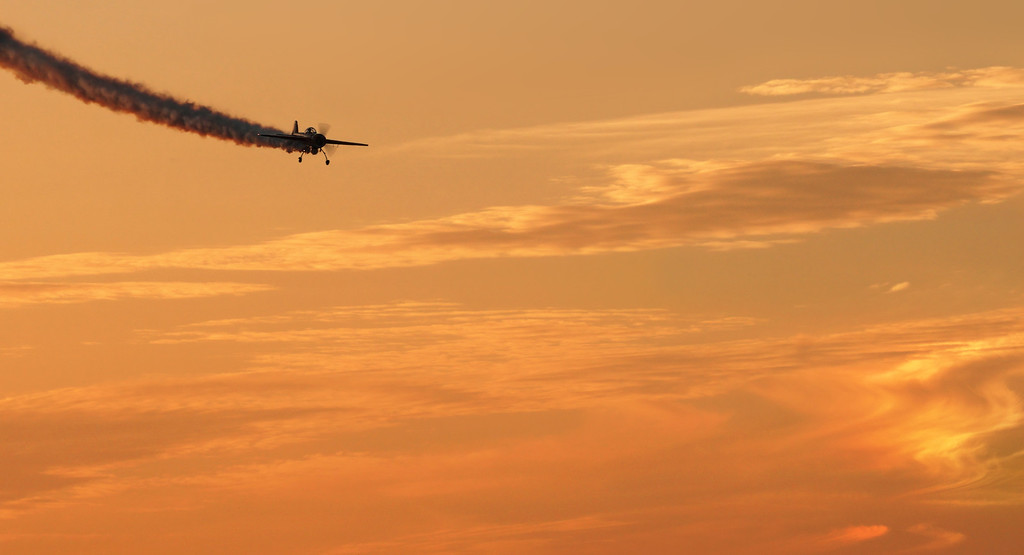 Aerobatic plane at sunset.