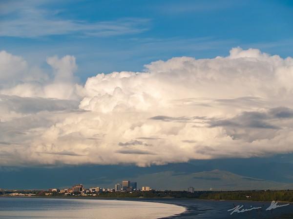 Thick cumulus sprawled over the Chugach