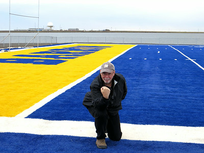 "Ed ""tebowing"" on the blue astroturf football field at Barrow HS. Seems silly now but it was quite funny at the time :)"
