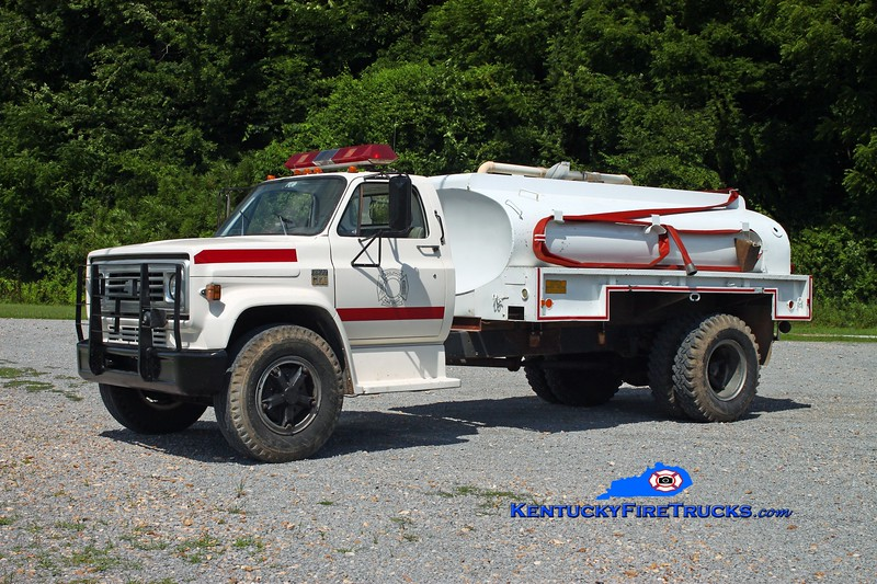 <center> Adolphus  Tanker 84 <br> On loan from Kentucky Division of Forestry <br> 1984 Chevy C60/Local 250/1250 <br> Kent Parrish photo <br> </center>