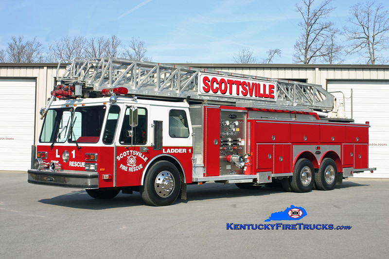 <center> Scottsville  Ladder 1 <br> 1986 E-One Hurricane 1250/300/110' <br> Kent Parrish photo </center>