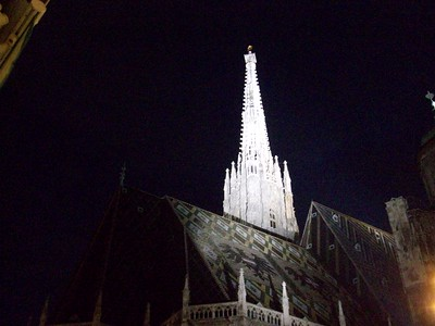 Lights illuminate the 450 foot south spire of Stephansdomkirche. The south spire was added sometime in the 15th century.