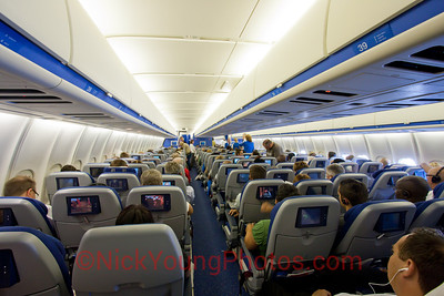 Onboard Economy Class on KLM's MD-11 from Amsterdam to Atlanta.