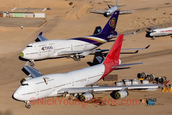 Qantas and Thai Airways 747-400s ready for the scrapheap.