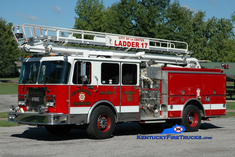 <center> La Center City Engine 17 <br> x-South Trail, FL <br> 1990 Spartan Gladiator/FMC 1250/500/50' Telesqurt  <br> Greg Stapleton photo </center>