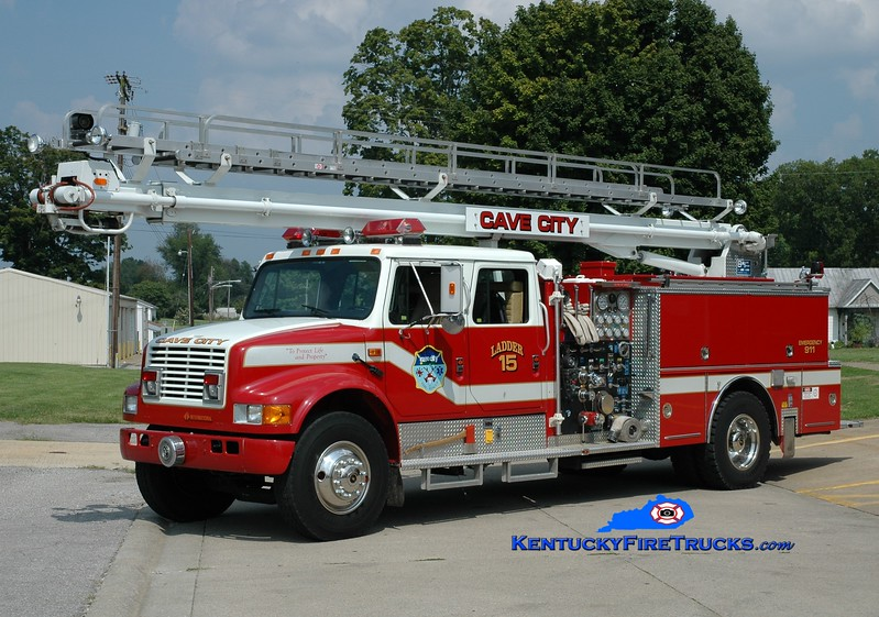 <center> RETIRED  <br> Cave City  Ladder 15  <br> x-Woodlawn, KY <br> 1990 International 4900/Boardman 1250/500/55' Read-Tower <br> Greg Stapleton photo </center>