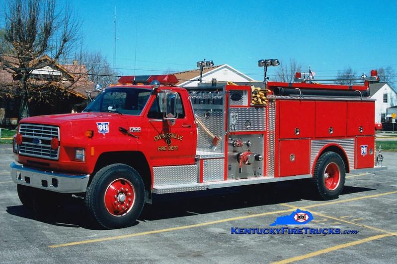 <center> Owingsville   Engine 1 <br> 1989 Ford F-800/Allegheny 1000/1000  <br> Greg Stapleton photo </center>