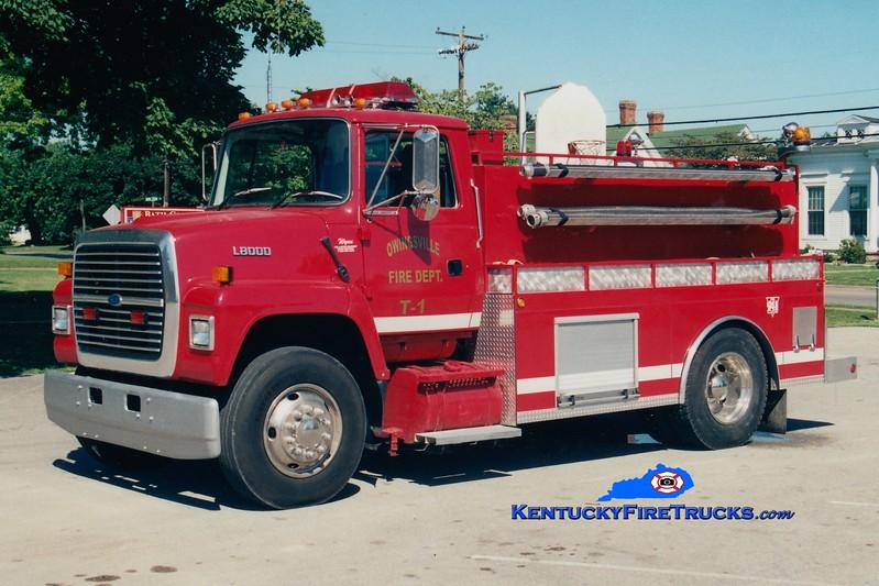 <center> Owingsville   Tanker 1 <br> 1995 Ford L8000/Wynn 250/1500  <br> Greg Stapleton photo </center>