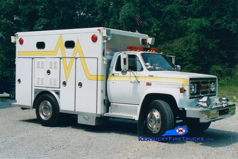 <center> RETIRED <br> Bell County Rescue 1  <br> x-Laurel County, KY <br> 1987 GMC/E-One  <br> Greg Stapleton photo </center>