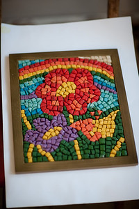 Ingenuity.   This is a mosaic that was made with water, flour, salt and a little bit of color. It is brilliant.   I went and had a meeting with the women in charge of the cultural center a few weeks ago. We talked about possibly getting a machine to cut tiles for mosaic art for the kids. I helped her search on the internet for these machines for a couple of hour, all of which were pretty expensive, and then resolved to come back the following day to take up the conversation again. I returned and was shown this. Genius. Pure genius. You can get by with a lot less than you think.