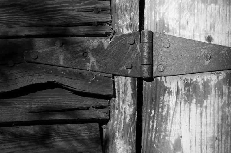 A rusty old hinge on a barn door. This was taken in the ruins of an old farm along the Fall Lake trail. Also part of the Mountains To Sea trail.<br /> best print size - 8x12 or 12x18