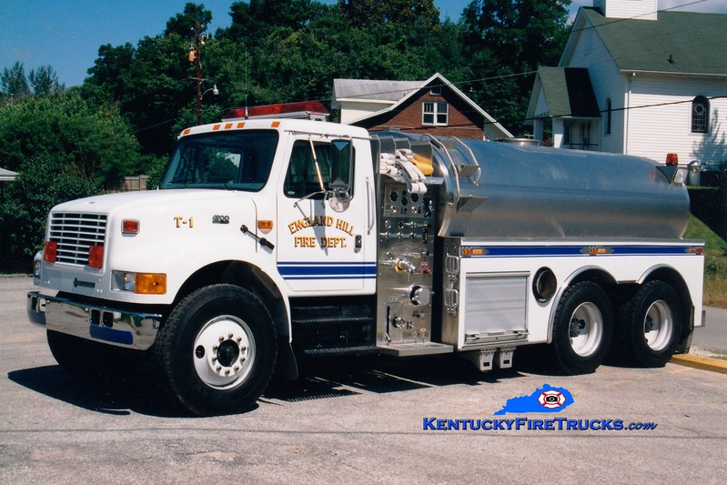 <center> England Hill  Tanker 1 <br> 1996 International 4900/S&S 500/2500 <br> Greg Stapleton photo <br> </center>