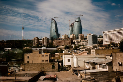 "August 2011, Baku, Azerbaijan  Baku's iconic ""Flame Towers""  emerging in the background, while the smaller houses in the foreground are set for demolition.  Since the flow of money has poured into Baku thanks to the Baku Tbilisi Ceyhan (BTC) oil pipeline, the Azeri capital has gone through intensive redevelopment.  However human rights organisations criticise the way in which inhabitants of old Baku have been forcefully evicted from homes earmarked for demolition with inadequate compensation."