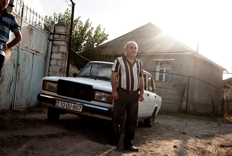 August 2011, Ganja, Georgia:  A farmer with his new car, which he purchased using the money given to him by the BTC consortium to let them use his land to lay the underground pipeline.   Since 2006 the BTC has allowed Azerbaijan to export its oil to world markets through Georgia and Turkey, thus avoiding Russia.  It has given Azerbaijan a greater sense of independence and a new role for Georgia in Europe's energy security to the annoyance of Russia.  Some blame the BTC for Russia's continued covert involvement in regional latent conflicts especially the South Ossetian crisis which led to the Russia-Georgia war.