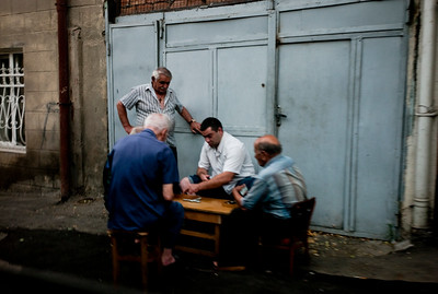 August 2011, Baku:    Men playing board game on the streets of Baku.  Since the oil has begun to flow through the Baku-Tbilisi-Ceyhan (BTC) oil pipeline, a new rich elite has sprung up in Baku.  The disparities between rich and poor are however still enormous.