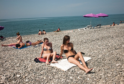 August 2011, Batumi, Georgia:  Young women sun bathe on the pebbled beach in Batumi.   Since 2006 the BTC has allowed Azerbaijan to export its oil to world markets through Georgia and Turkey, thus avoiding Russia.  It has given Azerbaijan a greater sense of independence and a new role for Georgia in Europe's energy security to the annoyance of Russia.  Some blame the BTC for Russia's continued covert involvement in regional latent conflicts especially the South Ossetian crisis which led to the Russia-Georgia war.