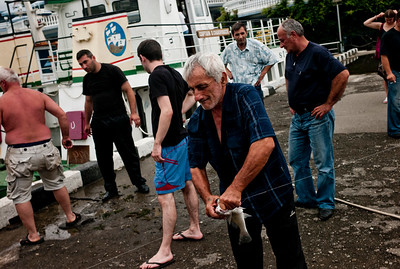 August 2011, Batumi, Georgia  Men fish near the harbour in Batumi from where some of the oil from caspian sea gets transported to different  parts of europe and beyond.    Since it became operational in 2006 the BTC has allowed Azerbaijan to export its oil to world markets through Georgia and Turkey, thus avoiding Russia.  It has given Azerbaijan a greater sense of independence and a new role for Georgia in Europe's energy security to the annoyance of Russia.  Some blame the BTC for Russia's continued covert involvement in regional latent conflicts especially the South Ossetian crisis which led to the Russia-Georgia war.