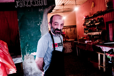 August 2011, Tbilisi, Georgia  -  Portrait of a butcher  in Tbilisi, where the oil money has the divided the rich and power in a larger extent.   Since 2006 the BTC has allowed Azerbaijan to export its oil to world markets through Georgia and Turkey, thus avoiding Russia.  It has given Azerbaijan a greater sense of independence and a new role for Georgia in Europe's energy security to the annoyance of Russia.  Some blame the BTC for Russia's continued covert involvement in regional latent conflicts especially the South Ossetian crisis which led to the Russia-Georgia war.