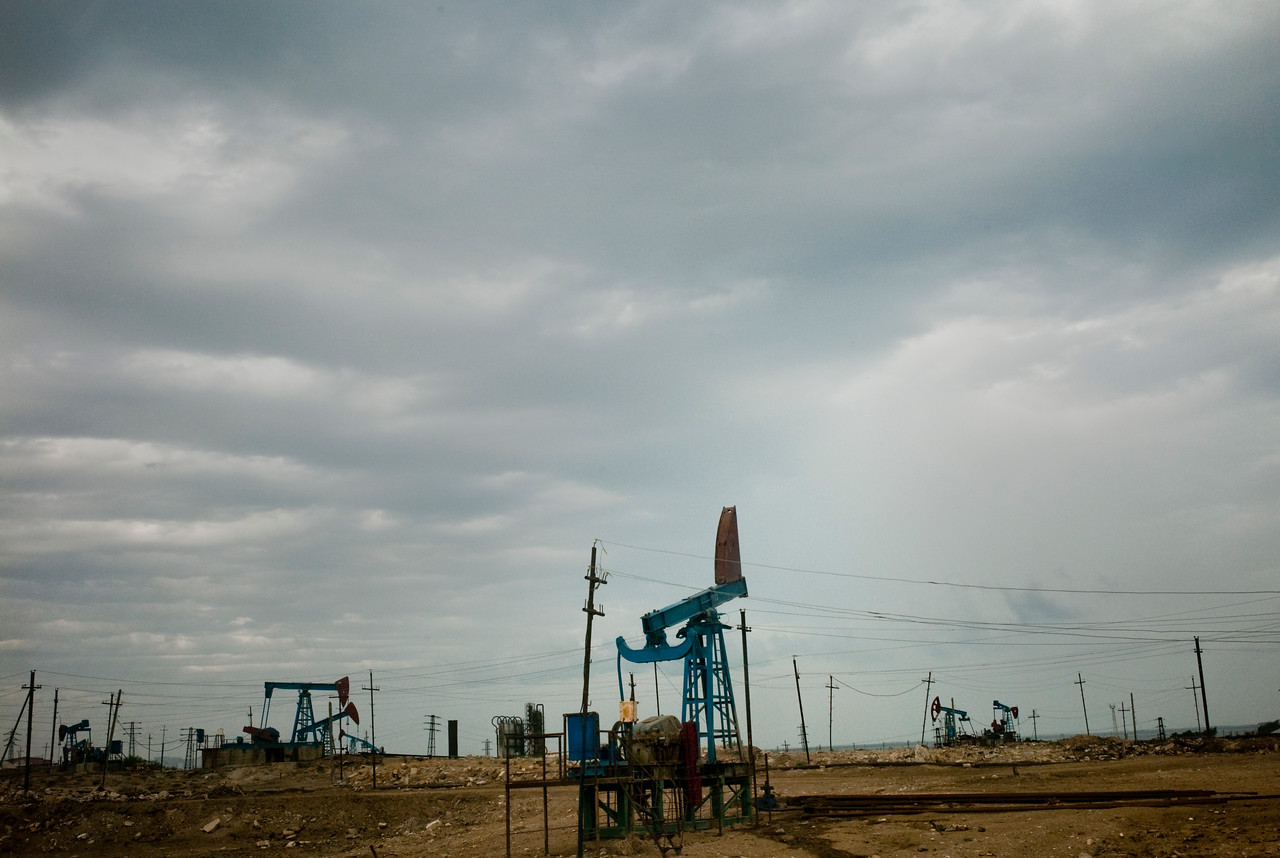 August 2011, Baku, Azerbaijan:  Oil field with number of rigs, owned State Oil Company of Azerbaijan Republic (SOCAR).   Since it became operational in 2006 the BTC has allowed Azerbaijan to export its oil to world markets through Georgia and Turkey, thus avoiding Russia.  It has given Azerbaijan a greater sense of independence and a new role for Georgia in Europe's energy security to the annoyance of Russia.  Some blame the BTC for Russia's alleged continued covert involvement in regional latent conflicts (Abkhazia, South Ossetia, Nagorno Karabakh).