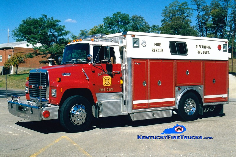 <center> RETIRED <br> Alexandria  Rescue 120  <br> 1990 Ford L8000/Ranger  <br> Greg Stapleton photo </center>