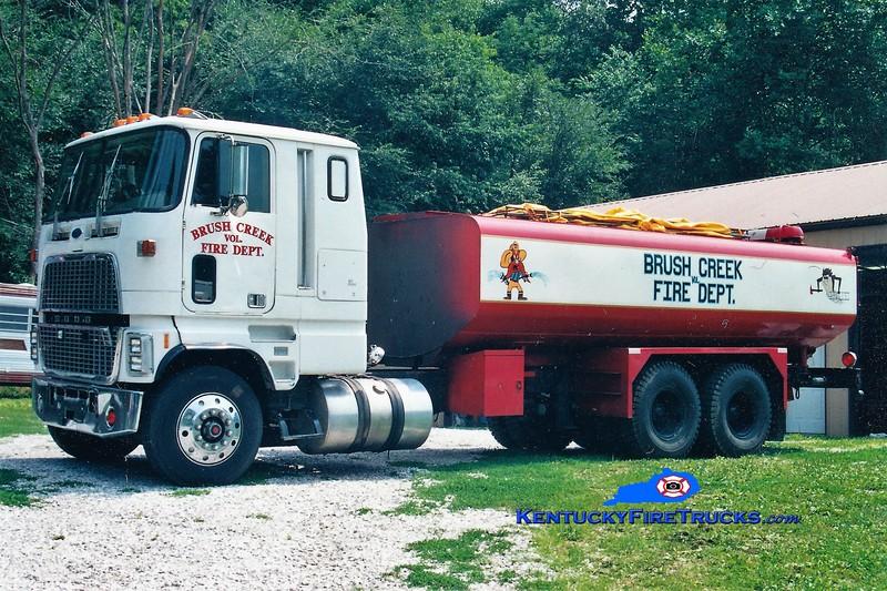 RETIRED<br /> Brush Creek Tanker 1<br /> 1977 Ford/Local 1250/5000<br /> Greg Stapleton photo