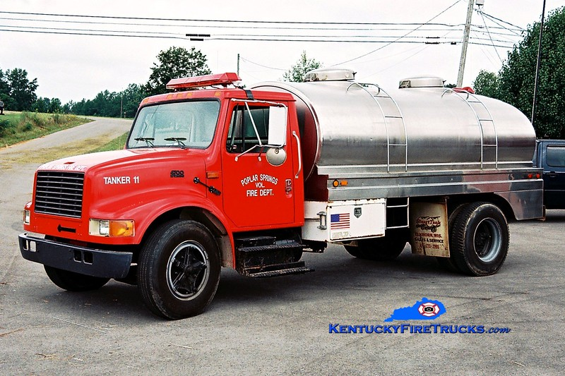 <center> Poplar Springs Tanker 11 <br> 1995 International 4700/Stuart Tank 250/1800  <br> Greg Stapleton photo </center>