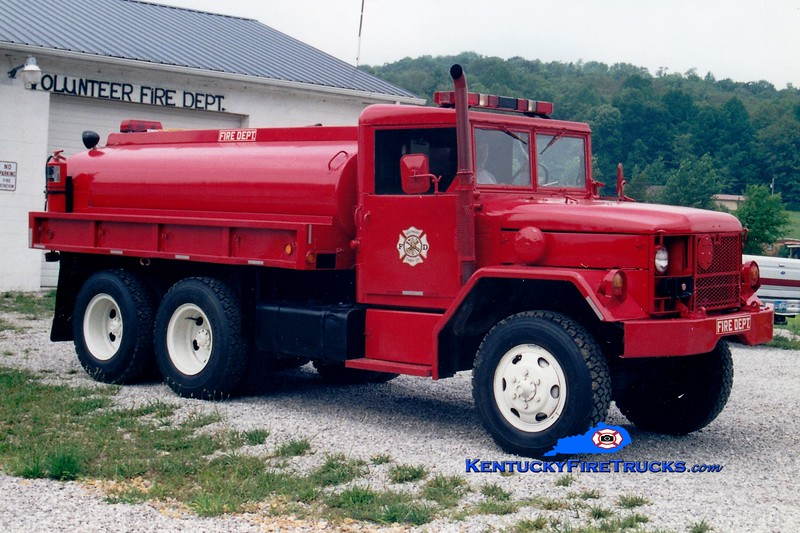<center> RETIRED <br> Southeast Casey  Tanker 2 <br> 1980 AM General M-49/Local 250/1200 <br> Greg Stapleton photo </center>