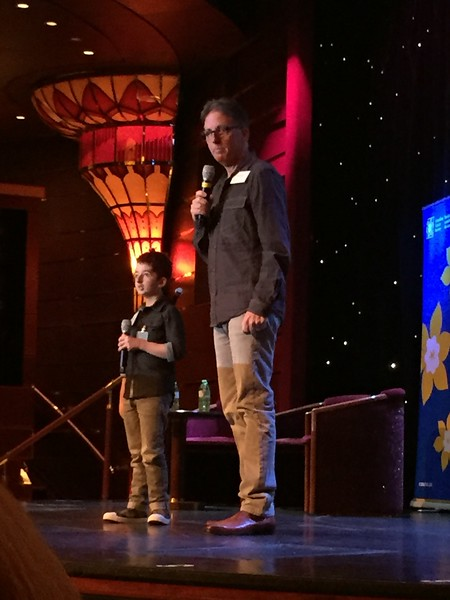 Casey and his dad Larry Wright on stage Holland America