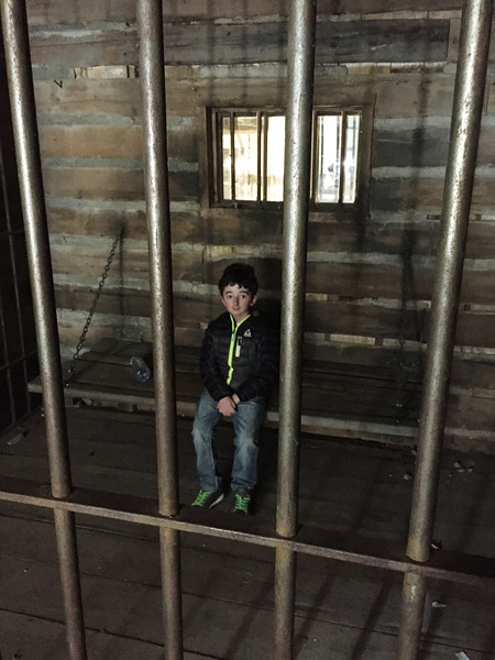 Casey Wright in jail on set at Bordertown