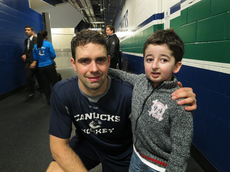Vancouver Canucks Dan Hamhuis with Casey Wright