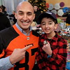 Wide receiver for the bC Lions, Marco Iannuzzi with Casey Wright holing onto his 2011 Grey cup ring