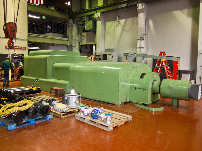 This is a steam-turbine powered 5 megawatt generator. It is used for co-generation where the power plant supplies its own electricity and can also be used for emergency power to the campus.