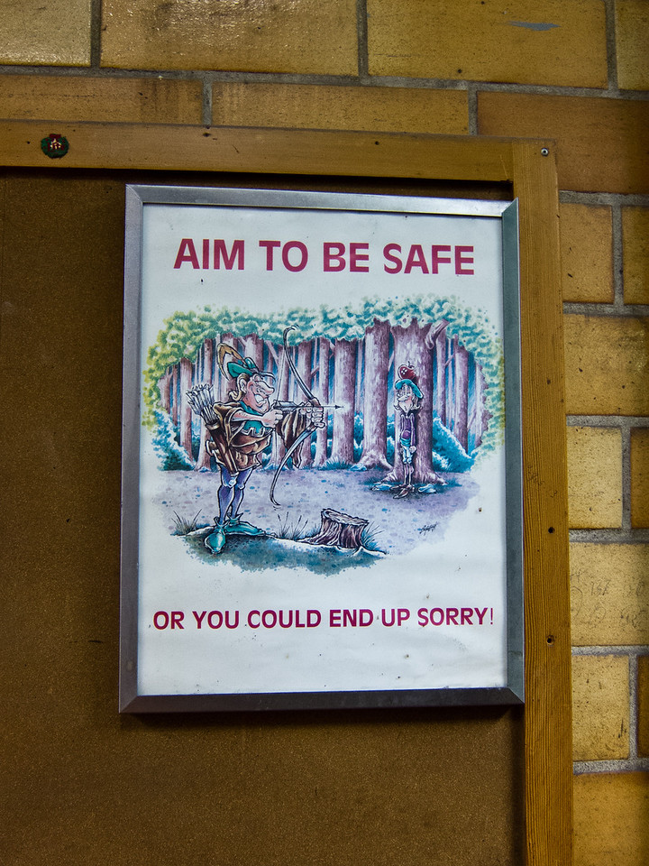 A somewhat dated safety sign. Looks to be from the 60's?