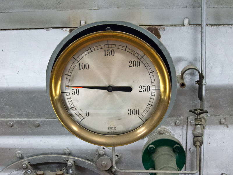 "A gauge on the front of one of the boilers. I love retro machinery. The look has spawned a literary genre and art movement known as ""steam punk."" Caveat: steam punk actually refers to Victorian era steam power and mechanisms. The design of older machinery in the Power Plant is more accurately described as Art Deco."
