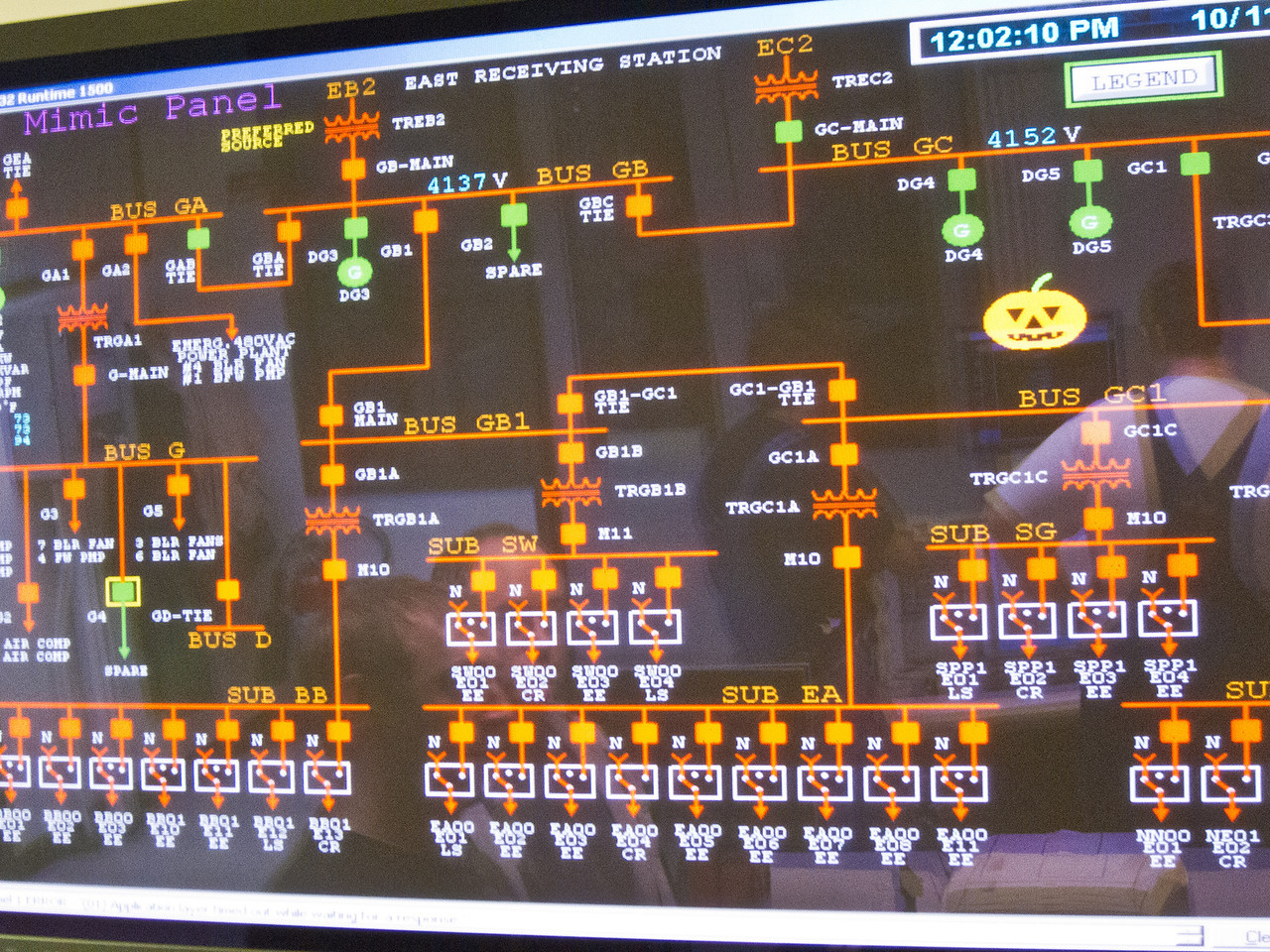 This large flat-panel screen is displaying the emergency electrical circuits. The generators are at the top with building loads twoard the bottom. The emergency power is distributed at 4kV. The red/orange lines show hot (energized) circuits. The white rectangles are switches that will toggle if line power is lost. Note the seasonal decoration!