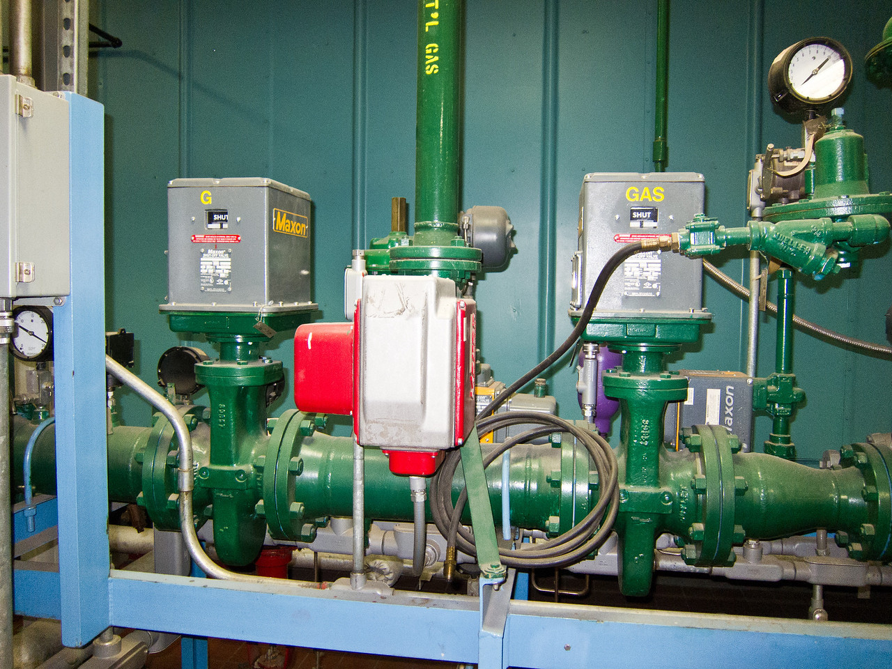 The natural gas supply shut off mechanism. There are two in-line valves to provide a redundant shut-off capability. This is a fail-safe mechanism to shut down the boiler if a dangerous condition were to develop.