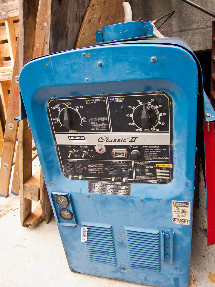 An old arc welder sitting outside. It's 3 year warrantee expired a long time ago!
