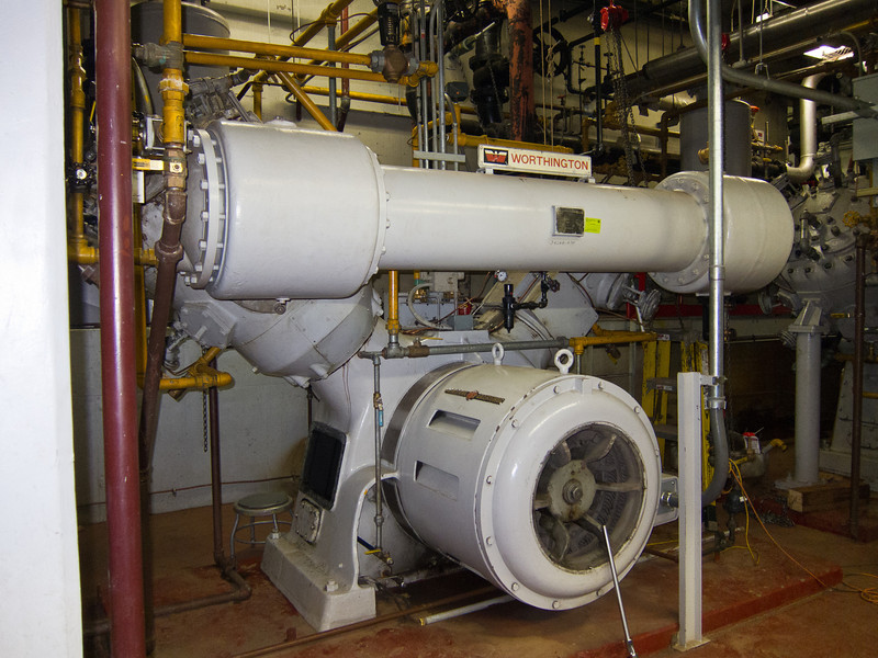 There are four compressors to supply compressed air to the facility and to the campus. This is one of two ginormous reciprocating piston units. The pistons must be a foot or more in diameter. The other two compressors are more modern turbine and rotary screw models.