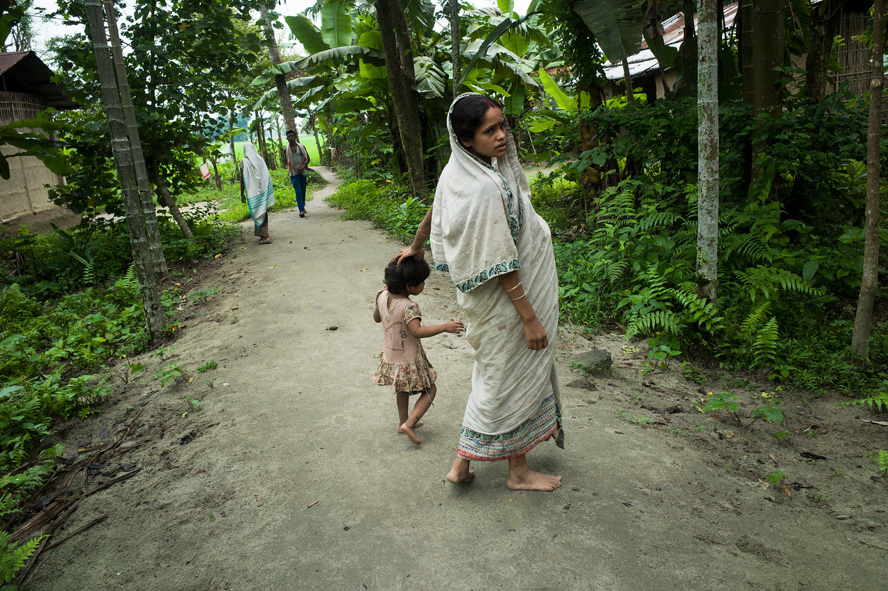 Dhemanji, Assam, India August,2014:   Pink Das (17) seen with her child near her home in Both- Doi village outside of Dhemanji town.  Pink Das was married when she was 12 years 6 months old and has a 18 months old child and now she is pregnant.   Series on early marriages in Assam, India for Al Jazeera America.       Photo:  Sami Siva