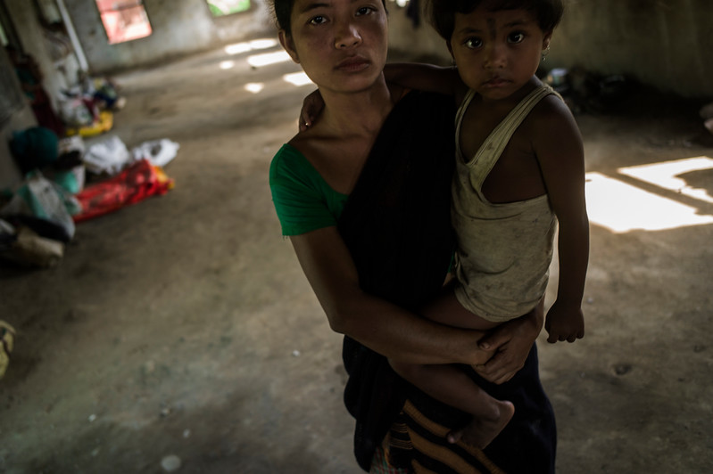 Dhemanji, Assam, India August,2014:   Nano Pame (23) was married when she was 15 and has a 7 year old child. She is displaced due to floods.   Series on early marriages in Assam, India for Al Jazeera America.       Photo:  Sami Siva